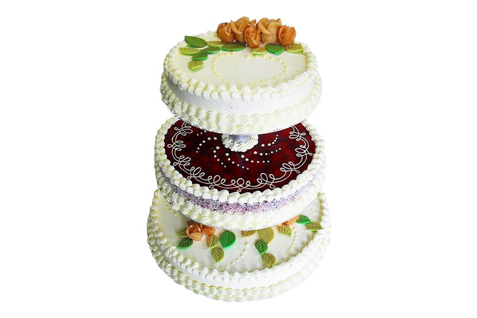 Dreistöckige Torte mit verschiedener Verzierung (Gelee und Marzipanblumen)